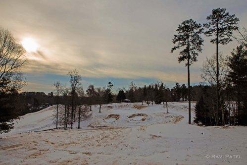 A Snowy Sunrise on the Golf Course