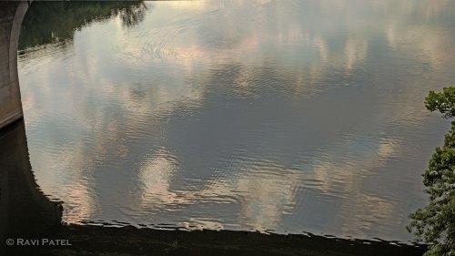 Cloudy Reflections Under a Bridge