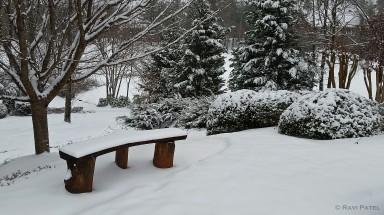 An Empty Snow Bench
