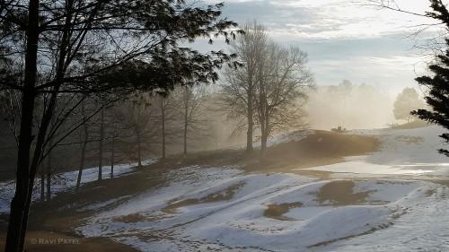 Foggy Sunrise over Melting Snow