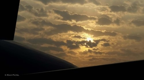 Sunset over the Tail of an Airplane