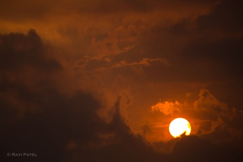 A Setting Sun Resting on the Clouds