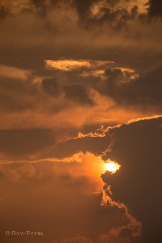 A Sun Captured by the Clouds